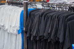 Black and white Variety. Of clothes hanging on rack in boutique Stock Image
