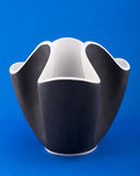 Black and white vase. On a blue background Royalty Free Stock Photo