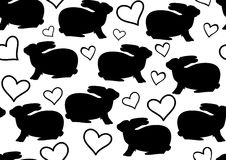 Black and white vector seamless pattern with rabbits and hearts Stock Image
