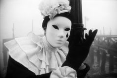 Black and white Venice carnival in the fog Stock Image