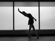 Black and white version of Ballet Dancer Backbend Silhouette. Ballet dancer silhouette framed by the window doing a backbend Stock Photography