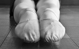 Black and White version of Canvas Ballet Dancer Slippers. A ballet dancer& x27;s pink canvas soft sole ballet slippers / shoes with a close up of her pointed Royalty Free Stock Photography