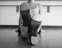 Black and white version of Crossed legs with Tap Shoes Stock Images