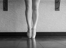 Black and White version of Growing Up Ballet Dancer. En pointe, the transition from canvas ballet shoes, to pointe shoes Stock Photography