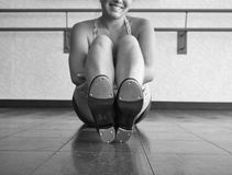 Black and White Version of the Happy Tapper. Smiling Teenager in tap class showing the bottom of her tap shoes Royalty Free Stock Photography