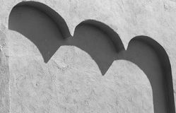 Black and white version of a stucco wall with three arches casti Stock Images