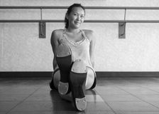 Black and White Version of Tap Dancer Things. Smiling teenage tap dancer sitting in the dance studio Stock Photography