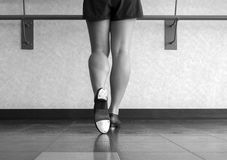 Black and white version of The Tap of A Tapper. Back of a Tap dancer& x27;s shoes at the barre Stock Photo
