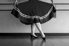 Black and white version of Teenager doing character ballet dance with skirt held in preparation. Character ballet class dance preparation stock images