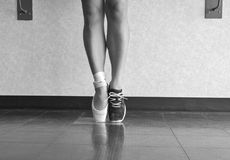 Black and White Version of Two Sides to A Dancer. Black and white version of A close up of a ballet dancer in her pointe shoes and runners Royalty Free Stock Photos