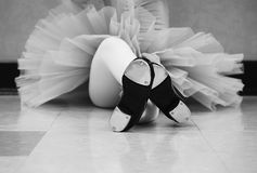 Black and white versions of Little girl wearing a tutu and tap shoes in her tap dance class. Black and white version of Little girl wearing a blue tutu and tap royalty free stock photos