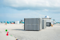 Black and white verticlly striped beack shed on beach Miami, Flo. Miami, Florida, USA - July 28, 2012; Striking black and white vertically striped black shed on Royalty Free Stock Photo
