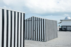 Black and white verticlly striped beack shed on beach Miami, Flo. Miami, Florida, USA - July 28, 2012; Striking black and white vertically striped black shed on Royalty Free Stock Image
