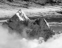 Black and white view of Ama Dablam with and beautiful clouds - Sagarmatha national park - Khumbu valley - Trek to Everest base cam Stock Photo