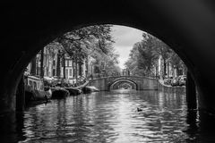 Black and White view of Amsterdam Canal and the Five bridges royalty free stock photos