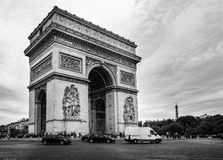 Black and white view of the Arc de Triomphe with the Eiffel Tower in the background stock photography