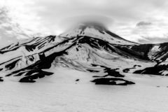 Black and white view of the Avacha Volcano in overcast weather, Kamchatka Peninsula, Russia royalty free stock image
