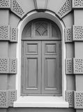 Black and white view of Closed wooden door in European style Royalty Free Stock Photo