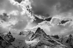Black and white view on evening mountains in sunlight clouds Royalty Free Stock Image