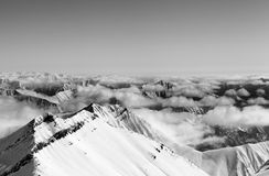 Black and white view on high winter mountains in haze Royalty Free Stock Photography