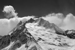 Black and white view on mountain glacier covered with snow Royalty Free Stock Photo