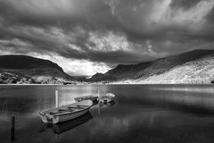 Black and white Landscape image of rowing boats on Llyn Nantlle Stock Photos
