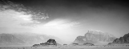 Black and White view of sand and rocky outcrops, Wadi Rum, Jordan Stock Photos