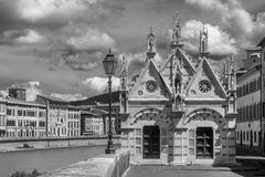 Black and white view of Santa Maria della Spina, beautiful Church on the banks of the Arno river in Pisa, Tuscany, Italy. Europe Royalty Free Stock Photo