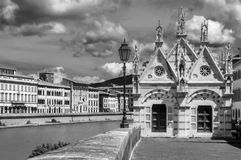 Black and white view of Santa Maria della Spina, beautiful Church on the banks of the Arno river in Pisa, Tuscany, Italy. Europe Stock Image