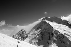Black and white view on ski slope and snow mountain in winter Stock Photography