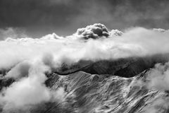 Black and white view on slope for freeriding at mist and sunligh. T clouds. Caucasus Mountains in winter, Georgia, region Gudauri Royalty Free Stock Image