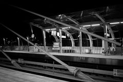 Metallic structures. Black and white view of train station on the bridge in Istanbul. Metallic lines, night scene, grey palette Royalty Free Stock Photo