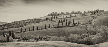Black and white view of Val Dorcia windy road and hill royalty free stock images