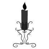Black and white vintage candle with a burning candle Royalty Free Stock Photo