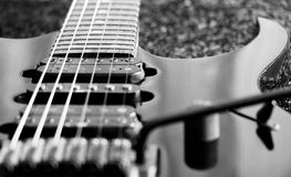 Black and white vintage electric guitar. With fretboard Stock Image