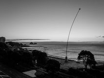 Black and White Vintage style shot of New Plymouth Foreshore and wind wand royalty free stock images