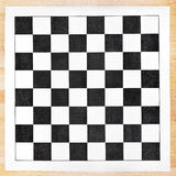 Black and white vinyl checkerboard on wooden table Royalty Free Stock Photos