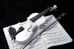 Black and white violin with music notes Royalty Free Stock Image