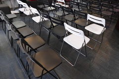 Black and white visitor chairs. In rows Stock Photo