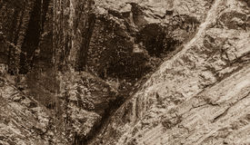 Black and white of water flowing down rocky ledge Royalty Free Stock Photo