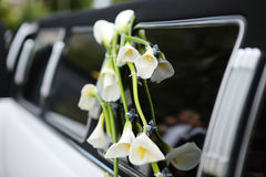 Black and white wedding limo. Wedding car decorated with white flowers Stock Photo