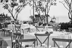 Wedding reception dinner table setting with folding lawn chairs in Black and White Royalty Free Stock Photography