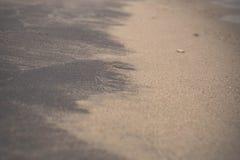 Black and white wet sand. Olchon island, Lake Baikal Royalty Free Stock Photography