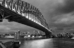 Black and white wide angle view of Sydney Harbour Bridge at nigh Royalty Free Stock Images
