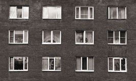 Black and white windows of the old multistory building Royalty Free Stock Photography