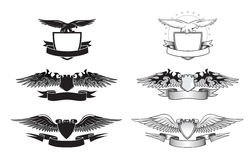 Black and white winged insignias Royalty Free Stock Images