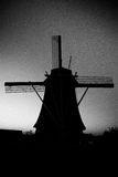 Black and white wings. Dutch wind mill black and white royalty free stock photo