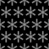 Black and white winter background. Seamless texture of crochet snowflakes Royalty Free Stock Photo