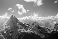 Black and white winter mountains with clouds Royalty Free Stock Images