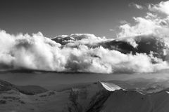 Black and white winter mountains in evening and sunlight clouds Stock Photo